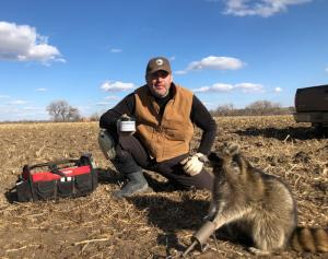 Alan Probst and Raccoon caught using Coon Buster.